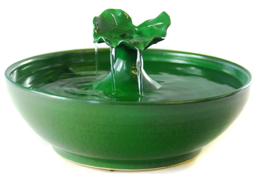 A pet water fountain in our beautiful dark green glaze water spouts up onto the leaf and falls - Decorative water spouts ...