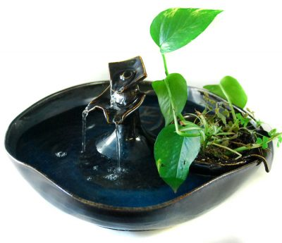 indoor fountain with planter