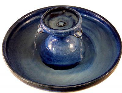 a ceramic cat fountain with three streams